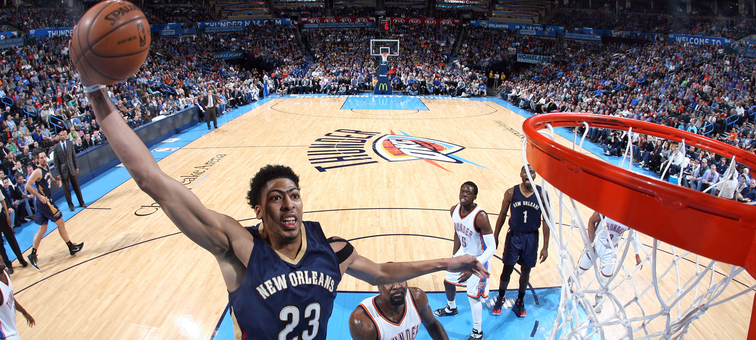 Anthony Davis soars for a one-handed dunk at Oklahoma City on Feb. 6