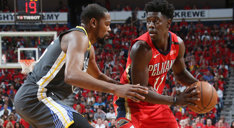 Jrue Holiday tries to operate against Golden State defender Kevin Durant