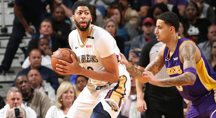 Anthony Davis posts up vs. Lakers forward Kyle Kuzma