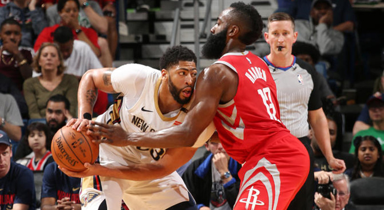 Anthony Davis tries to operate vs. Houston defender James Harden