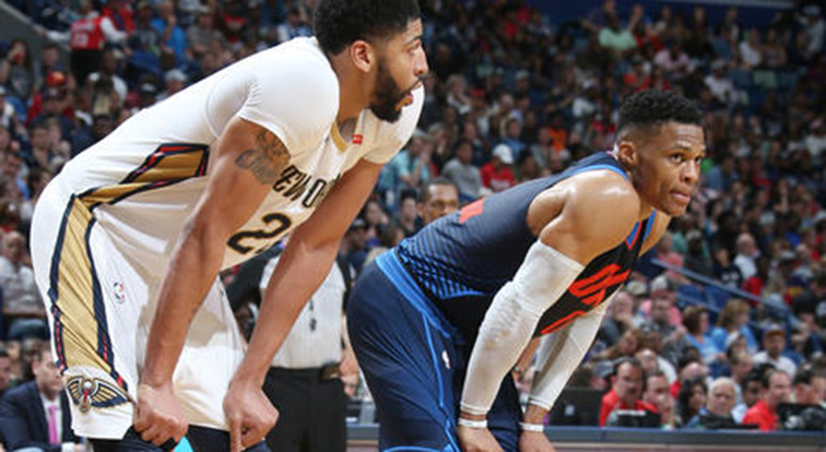 Anthony Davis and Russell Westbrook line up during a free throw
