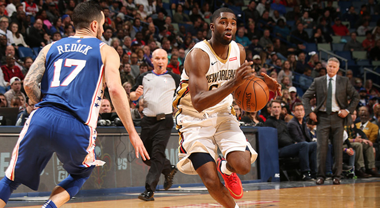E'Twaun Moore drives past Philadelphia's J.J. Redick