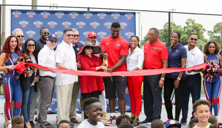 A group cuts the ribbon at Saturday's court dedication in New Orleans East