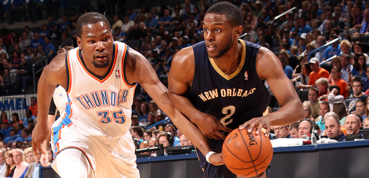 Darius Miller looks to drive past Kevin Durant
