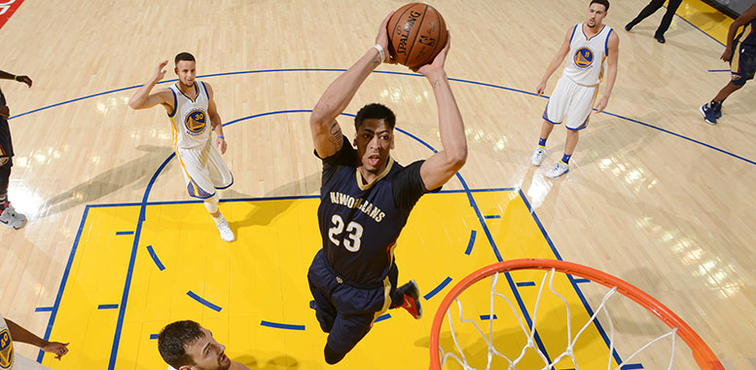 Anthony Davis soars for a dunk at Golden State
