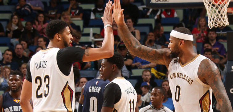 Anthony Davis (left) and DeMarcus Cousins give each other a high-five vs. Memphis last season