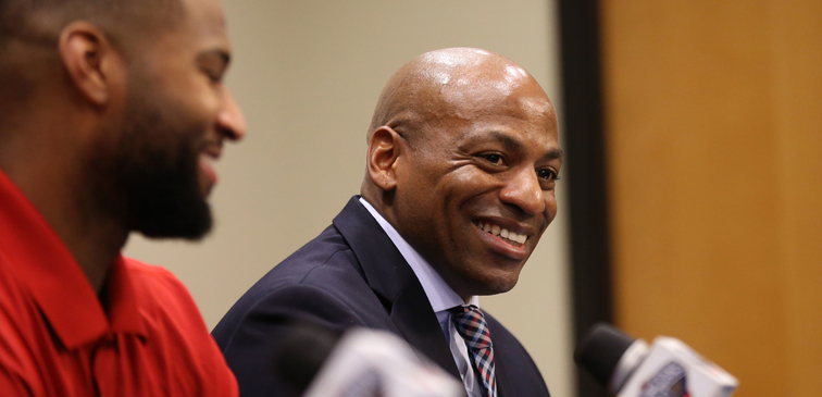 Dell Demps laughs during DeMarcus Cousins' introductory press conference