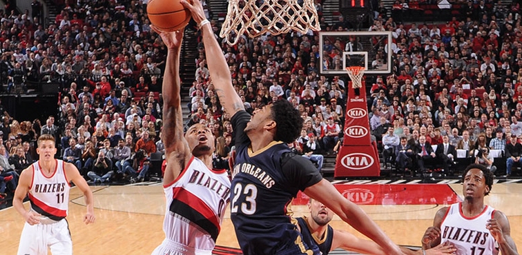 Anthony Davis rejects a shot by Portland guard Damian Lillard