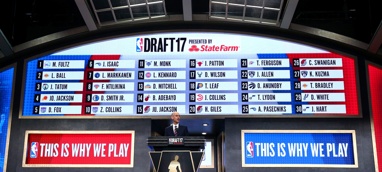 Adam Silver stands at the podium during Thursday's draft