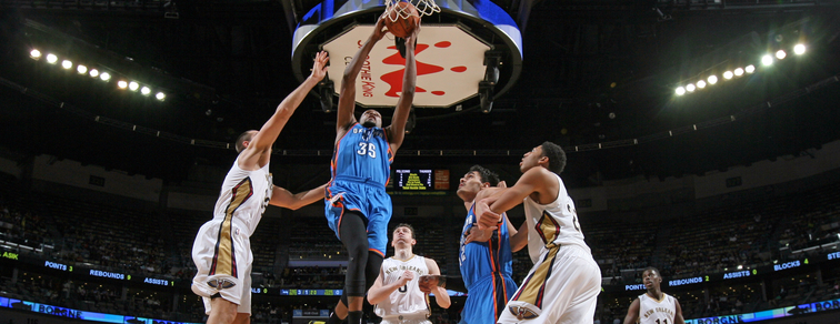 Kevin Durant takes it to the rim in the middle of New Orleans' defense in December