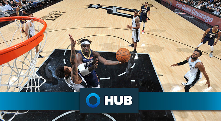 Jrue Holiday takes a shot in the lane over San Antonio's Dejounte Murray