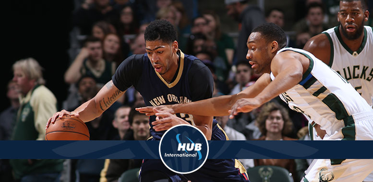 Anthony Davis grabs the ball and heads up court away from Milwaukee's Jabari Parker