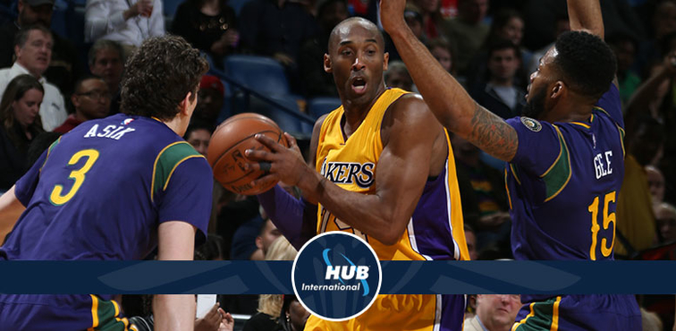 New Orleans defenders Omer Asik (left) and Alonzo Gee swarm Kobe Bryant