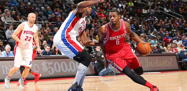 Terrence Jones tries to dribble past Detroit defender Anthony Tolliver