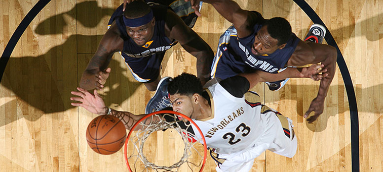 Anthony Davis vies with Memphis' Zach Randolph (left) and Tony Allen for a rebound
