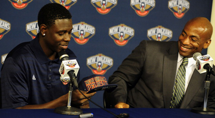 Jrue Holiday is given a Pelicans hat upon his trade acquisition in 2013