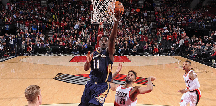 Jrue Holiday shoots a left-handed layup against Portland on Dec. 14