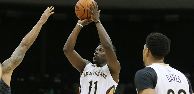Jrue Holiday shoots a mid-range shot vs. Atlanta in a preseason game