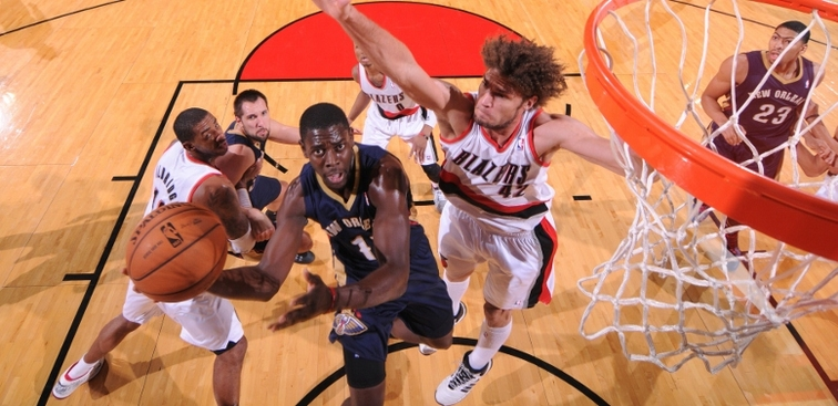 Pelicans guard Jrue Holiday shoots a layup at Portland last season