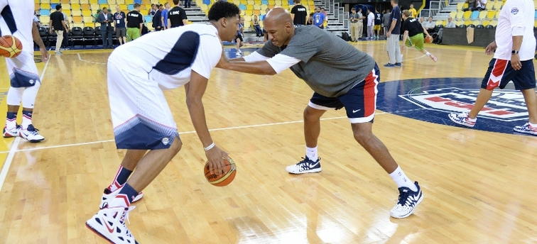 Anthony Davis and Monty Williams work out on the court prior to a USA exhibition game