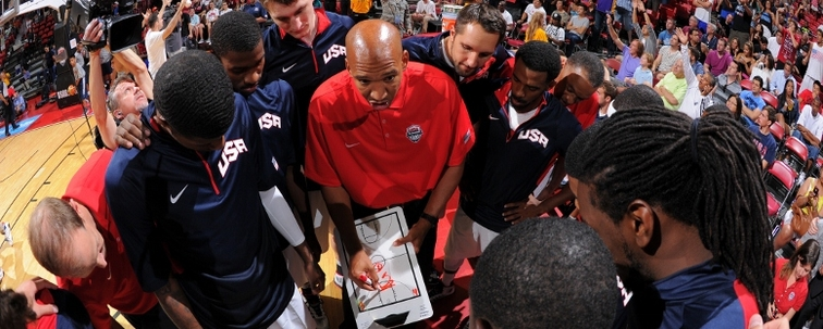 Pelicans coach Monty Williams directs a team huddle during a 2013 USA scrimmage
