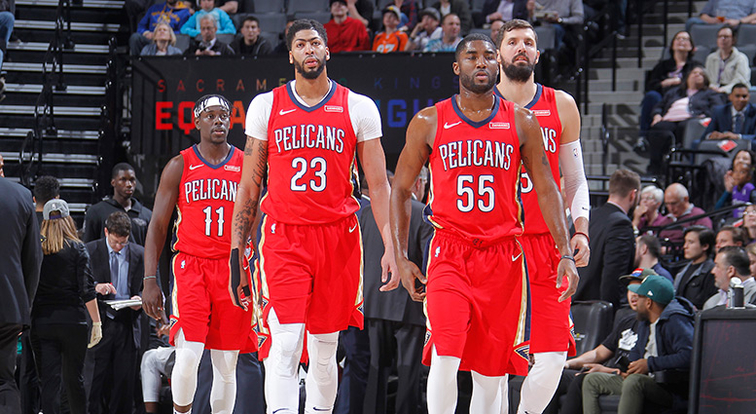 (left to right) Jrue Holiday, Anthony Davis, E'Twaun Moore and Nikola Mirotic walk onto the court at Sacramento in March