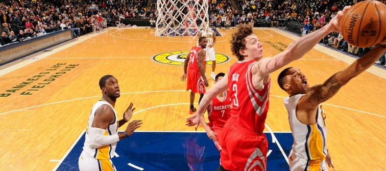 Omer Asik rejects a shot under the rim at Indiana