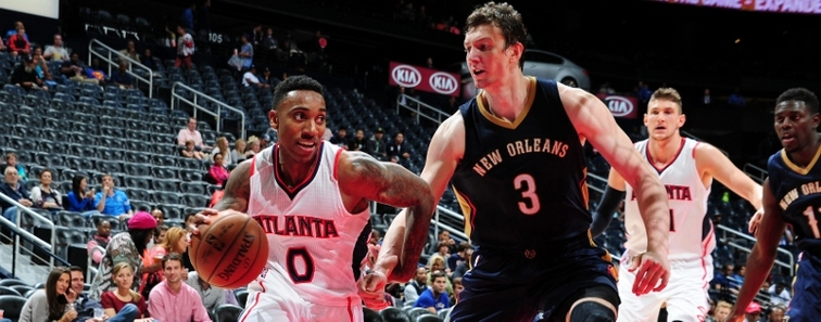 Pelicans center Omer Asik tries to stop Hawks guard Jeff Teague