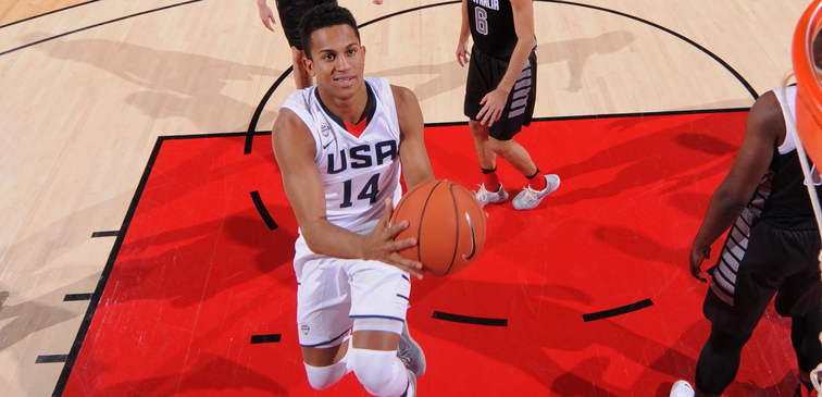 Frank Jackson scoops up a shot during international competition for USA Basketball