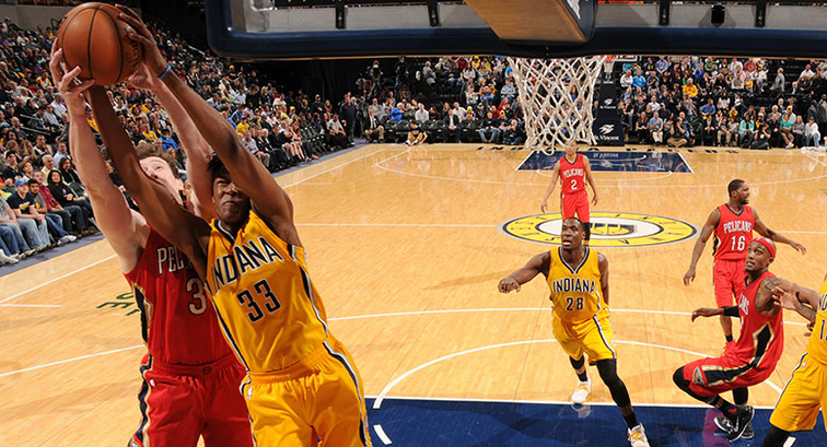 Omer Asik and Indiana's Myles Turner vie for a rebound