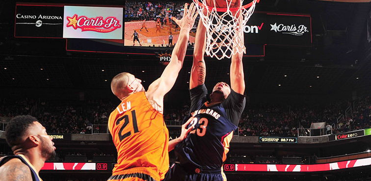 Anthony Davis throws down an alley oop dunk over Alex Len