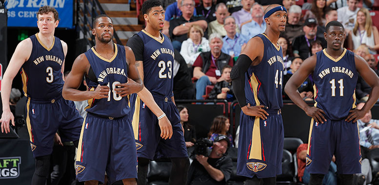 Omer Asik (left to right), Toney Douglas, Anthony Davis, Dante Cunningham and Jrue Holiday wait for play to begin in Sacramento