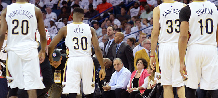 (left to right) Quincy Pondexter, Norris Cole, Ryan Anderson and Eric Gordon walk up the court