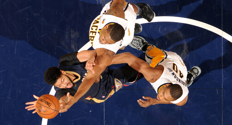 Anthony Davis takes a contested shot over two Pacers