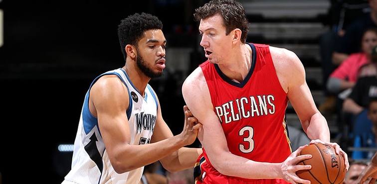 Omer Asik posts up against Karl-Anthony Towns