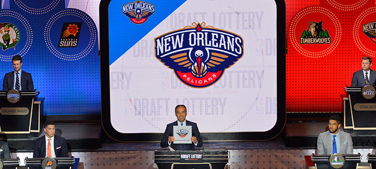 Mark Tatum holds up the Pelicans' logo card at the May draft lottery