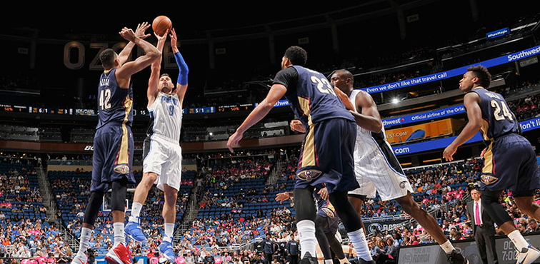 Orlando's Nikola Vucevic takes a mid-range jumper against New Orleans