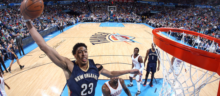 Anthony Davis rises for a one-hand dunk at Oklahoma City