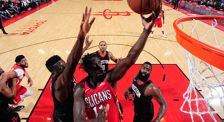 Jrue Holiday powers up for a layup at Houston last season