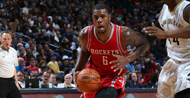 Then with Houston, Terrence Jones dribbles against New Orleans defender Dante Cunningham