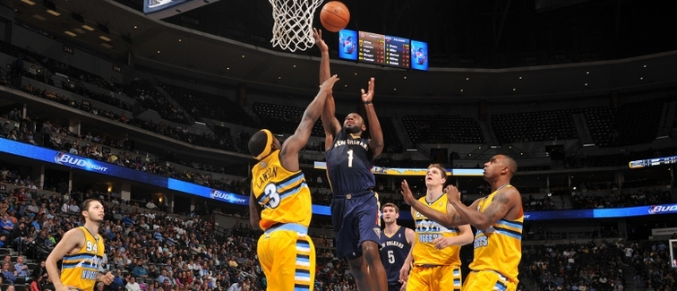 Tyreke Evans drives for a layup at Denver last season