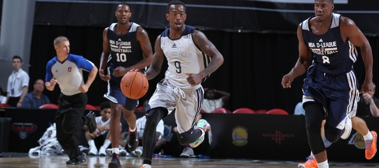 Russ Smith heads upcourt in a recent game vs. the D-League Select team