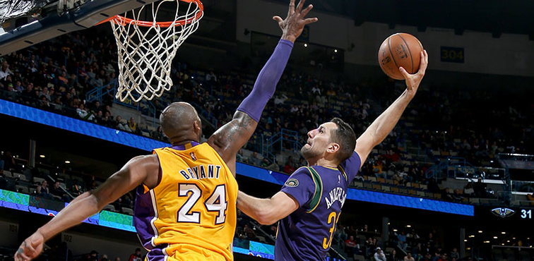 Ryan Anderson loads up to throw down a dunk over Lakers forward Kobe Bryant