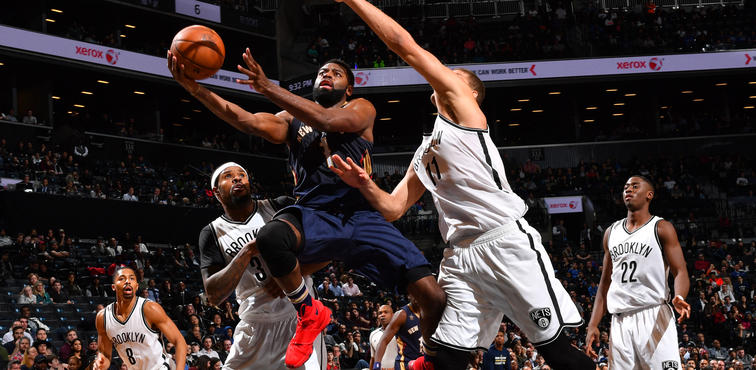 Tyreke Evans drives in for a layup at Brooklyn