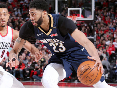Anthony Davis drives against Portland guard C.J. McCollum
