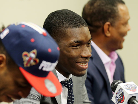 Cheick Diallo (middle) smiles during Friday's introductory press conference