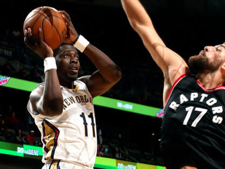 Jrue Holiday rises for a shot against Jonas Valanciunas
