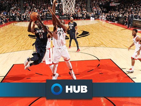 Jrue Holiday leaps to take a shot over Toronto's Serge Ibaka