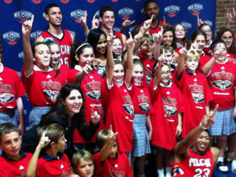 The Pelicans joined students at Metairie school St. Catherine's of Siena for the unveiling of a new red uniform