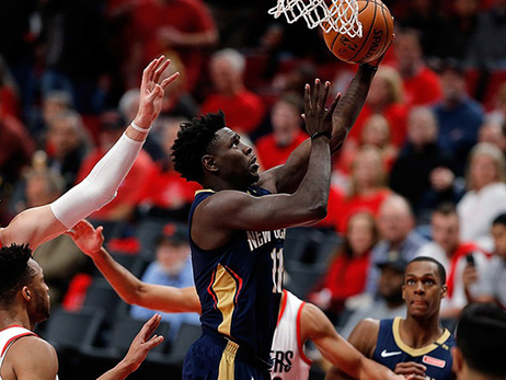 Normally mild-mannered, Jrue Holiday shows emotion, banters with fans, dunks on Blazers in Game 2